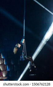 DNIPRO, UKRAINE - DECEMBER 14, 2018: Gymnast on the chains Diana Nose performs at the Circus.