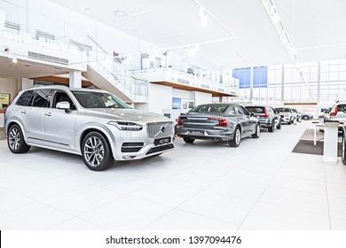 Dnipro, Ukraine - February, 01, 2019: panoramic view on cars showroom dealer shop interior with new car. Car in showroom of dealership Volvo