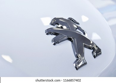 DNIPRO, UKRAINE - FEBRUARY 7, 2015: Silver chrome Peugeot logo on the hood of the car Peugeot 308 in a showroom. A roaring lion.