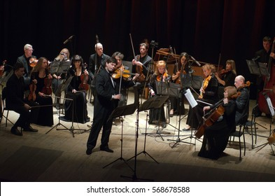 DNIPRO, UKRAINE - JANUARY 30, 2017: Famous violinist Eugene Kostritsky and members of the FOUR SEASONS Chamber Orchestra perform at the State Drama Theatre.