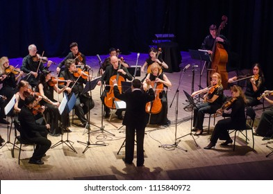 DNIPRO, UKRAINE - JUNE 18, 2018: FOUR SEASONS Chamber Orchestra - main conductor Dmitry Logvin perform  at the State Drama Theatre.