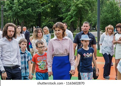 Dnipro, Ukraine - June 27, 2018: First Lady Marina Poroshenko and architect Sergey Derbin at opening of an inclusive park