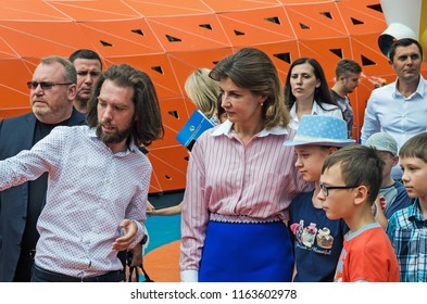 Dnipro, Ukraine - June 27, 2018: First Lady Marina Poroshenko, chairman of Dneprovsky regional state administration Valentin Reznichenko and architect Sergey Derbin at opening of an inclusive park
