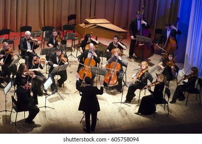 DNIPRO, UKRAINE - MARCH 20, 2017: FOUR SEASONS Chamber Orchestra - main conductor Dmitry Logvin perform at the State Drama Theatre.