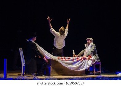 DNIPRO, UKRAINE - MARCH 23, 2018: Please, have a drink performed by members of the Dnipro State Drama and Comedy Theatre.