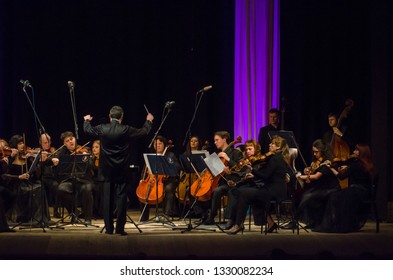 DNIPRO, UKRAINE – MARCH 4, 2019: FOUR SEASONS Chamber Orchestra - main conductor Dmitry Logvin perform at the State Drama Theatre.