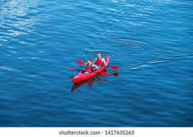Dnipro, Ukraine - May 07, 2017: Young couple riding a double kayak on a bright, sunny weekend