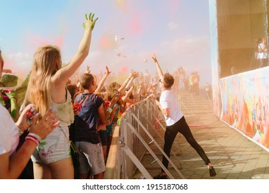 DNIPRO, UKRAINE – May 25, 2017. Crowd of happy young people have fun in colors during festival of colors ColorFest