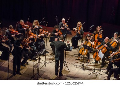 DNIPRO, UKRAINE - OCTOBER 22, 2018: Famous violinist Eugene Kostritsky and members of the FOUR SEASONS Chamber Orchestra - main conductor Dmitry Logvin perform  at the State Drama Theatre.