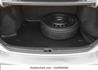 DNIPRO, UKRAINE - SEPTEMBER 01, 2018: TOYOTA COROLLA GREY COLOR, SPARE WHEEL IN THE TRUNK