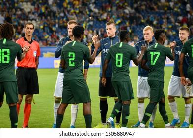 DNIPRO, UKRAINE - September 10, 2019: Nigeria football team shaking hands during the friendly match between national team Ukraine against Nigeria national team, Ukraine