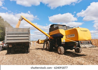 Dnipro, Ukraine - September 15, 2016: Agricultural harvester New Holland unload corn harvest into the truck