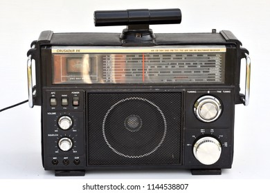 Dnipro, Ukraine - September 20, 2017: Old multiband radio receiver Crusader XK with an external transverse antenna on the top panel against white background