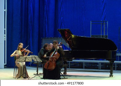 DNIPRO, UKRAINE - SEPTEMBER  26, 2016: Members of the Oberon Trio perform at the Philharmonic.