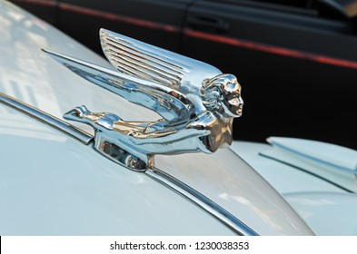 Dnipro, Ukraine - September 29, 2018: Decoration in the form of a flying lady on hood ornament of an retro car made of chromed metal
