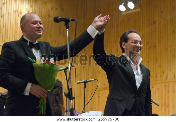 DNIPROPETROVSK, UKRAINE -?? FEB. 23: Pianist Vyacheslav Poprugin and Youth Symphony Orchestra FESTIVAL- conductor Dmitry Logvin perform at the Conservatory on Feb. 23, 2015 in Dnipropetrovsk, Ukraine