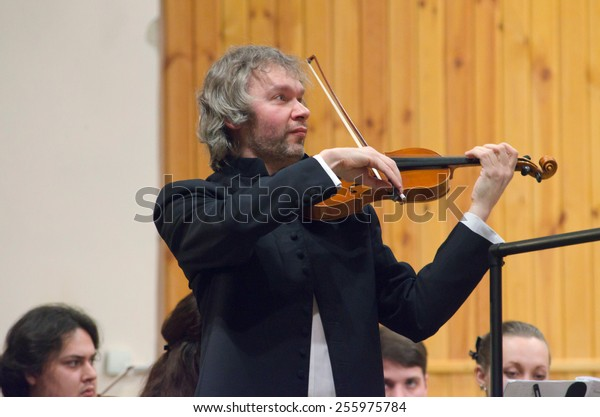DNIPROPETROVSK, UKRAINE -?? FEBRUARY 23: Famous violinist Alksandr Trostyansky and Youth Symphony Orchestra FESTIVAL  perform at the Conservatory on Feb. 23, 2015 in Dnipropetrovsk, Ukraine