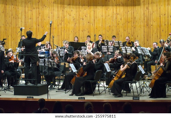 DNIPROPETROVSK, UKRAINE - FEBRUARY 23: Youth Symphony Orchestra FESTIVAL - main conductor Dmitry Logvin perform at the Conservatory on February 23, 2015 in Dnipropetrovsk, Ukraine
