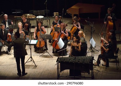 DNIPROPETROVSK, UKRAINE - JUNE 22, 2015: Famous performer Helen Shabelsky (vibraphone) and  FOUR SEASONS Chamber Orchestra - main conductor Dmitry Logvin perform at the State Russian Drama Theatre