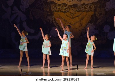 DNIPROPETROVSK, UKRAINE - JUNE 27, 2015: Unidentified girls, ages 7-15 years old, perform Letter to mom at State Opera and Ballet Theatre.