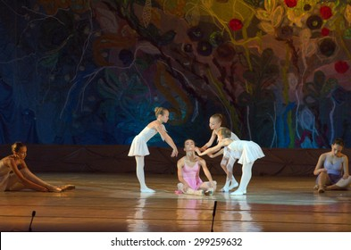 DNIPROPETROVSK, UKRAINE - JUNE 27, 2015: Unidentified girls, ages 7-15 years old, perform The whole world at State Opera and Ballet Theatre.