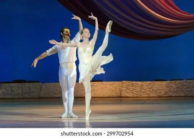 DNIPROPETROVSK, UKRAINE - JUNE 27, 2015:  Dancers Elena Pechenyuk and Dmitry Omelchenko perform BALANCHINE at State Opera and Ballet Theatre.
