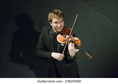 DNIPROPETROVSK, UKRAINE - MAY 14: Famous violinist Ostap Shutko performs at the State Russian Drama Theatre on May 14, 2015 in Dnipropetrovsk, Ukraine