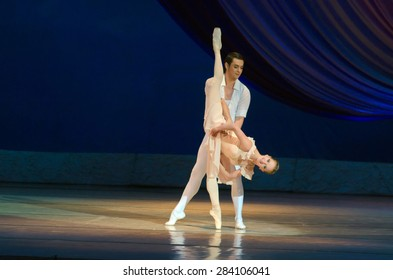 DNIPROPETROVSK, UKRAINE - MAY 30: Dancers Elena Pechenyuk and Dmitry Omelchenko perform BALANCHINE at State Opera and Ballet Theatre on May 30, 2015 in Dnipropetrovsk, Ukraine