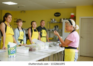 Dnipro/Ukraine - 06/14/2018: group of students listening woman chef cooking lesson.