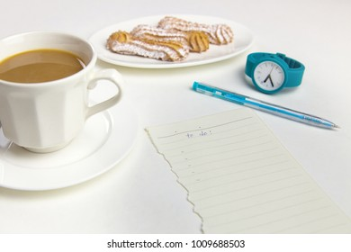 To do list with a morning coffee on a white background