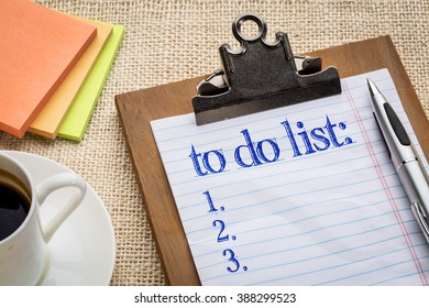 to do list on clipboard  with a pen, coffee and sticky notes against burlap canvas - office abstract