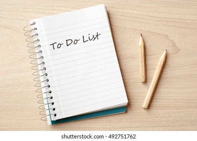 to do list on notebook  on desk