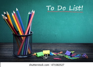 To do list text on green board and group of pencils