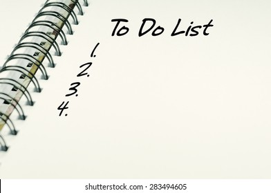 To Do List word on white notebook - Business Concept