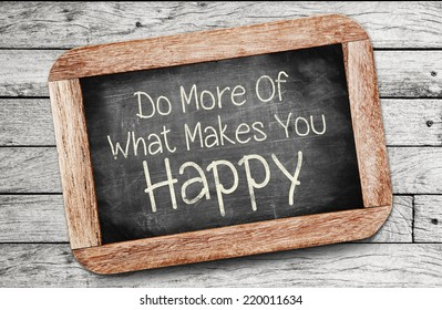 Do More Of What Makes You Happy Concept ,written on chalkboard.