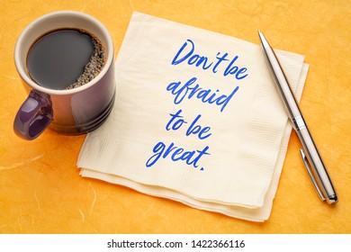 Do not be afraid to be great - inspirational handwriting on napkin with a cup of coffee