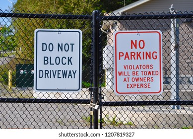 Do not block driveway and no parking signs posted on the gate