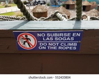 do not climb ropes sign