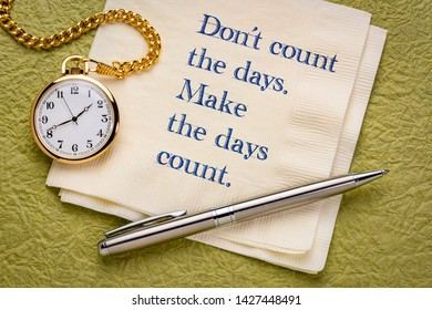 Do not count the days, make the days count - handwriting on a napkin with pocket watch.