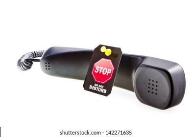 Do not disturb label with a thumbtack and phone tube. Do not disturb with your calls concept. Isolated on white.
