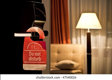 do not disturb sign hanging on open door in a hotel
