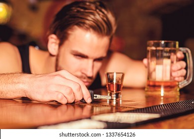 Do not drive drunk. Man drinker with car keys in pub. Handsome man drink beer at bar counter. Alcohol addict with beer mug. Alcohol addiction and bad habit. Addicting to alcoholic drink.