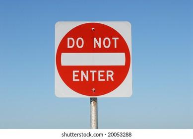 Do Not Enter sign against blue sky
