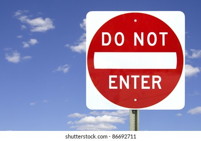 Do not enter sign on blue sky background with clipping path