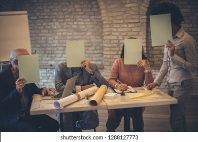 Do not ever hide from your business obligations. Business people in the office hiding behind paper. Copy space.