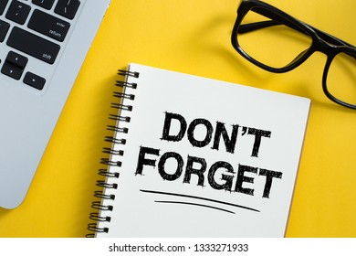 Do Not Forget Concept reminder on office desktop top view.