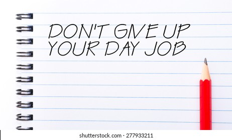 Do Not Give Up Your Day Job Text written on notebook page, red pencil on the right. Motivational Concept image