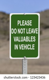 Do not leave valuables in vehicle warning sign.