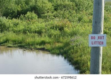 Do not litter sign beside pond in Nova Scotia