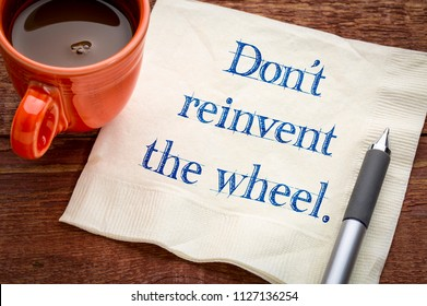 Do not reinvent the wheel - handwriting on a napkin with a cup of coffee